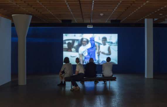 Sondra Perry, IT'S IN THE GAME '17 or Mirror Gag for Vitrine and Projection, 2017, single channel video, loop, color, sound, 16′34′′, installation view, 10. Berlin Biennale, Akademie der Künste (Hanseatenweg), Berlin, courtesy Sondra Perry; Bridget Donahue, New York. Photo: Timo Ohler