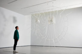 A visitor stands under Cerith Wyn Evans' Composition for 37 flutes on display as part of The Hepworth Prize For Sculpture 26 October 2018 - 20 January 2019. Photo: David Lindsay