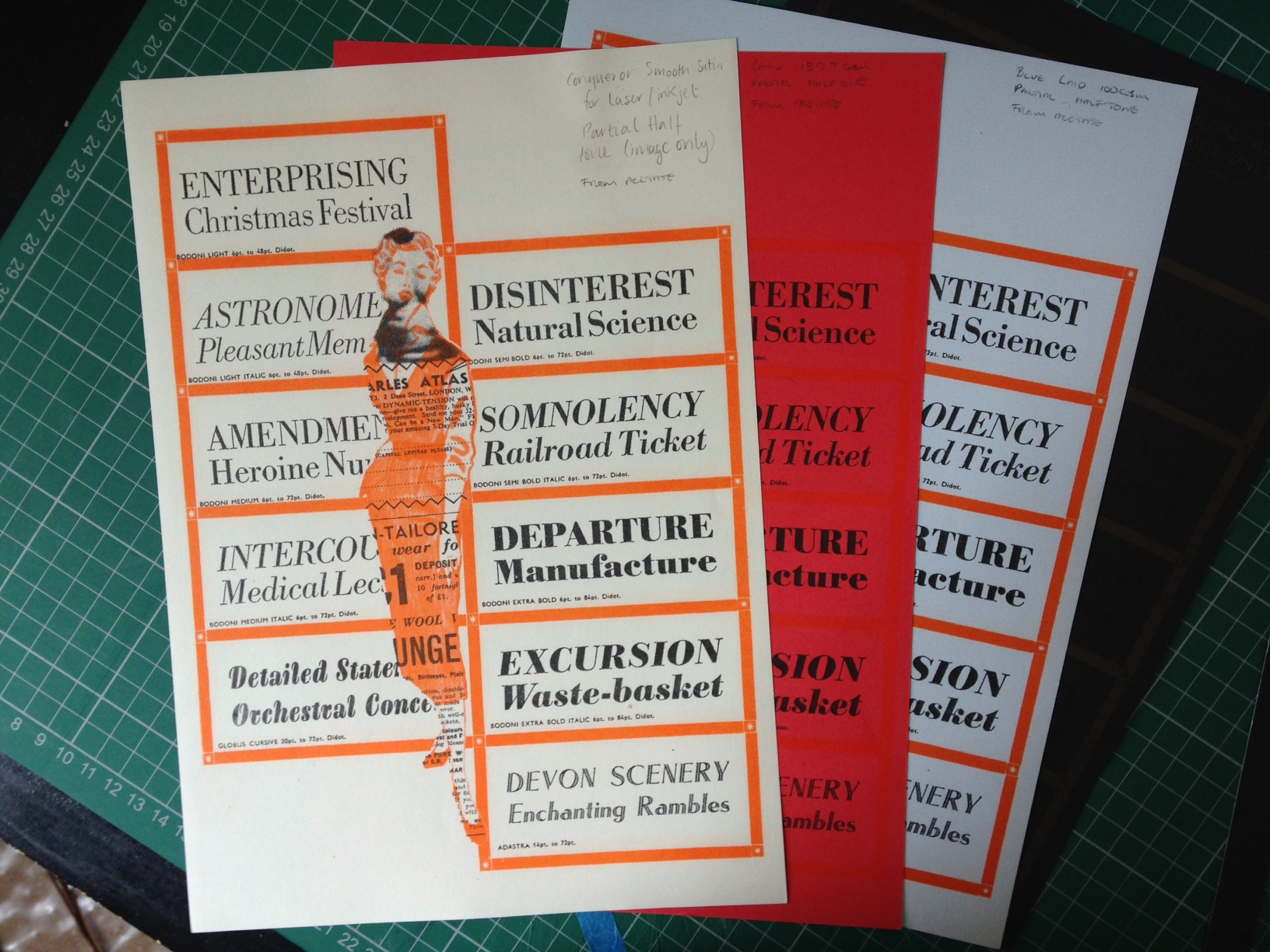 Shows a fan pf papers printed in orange and black, text and image of a woman