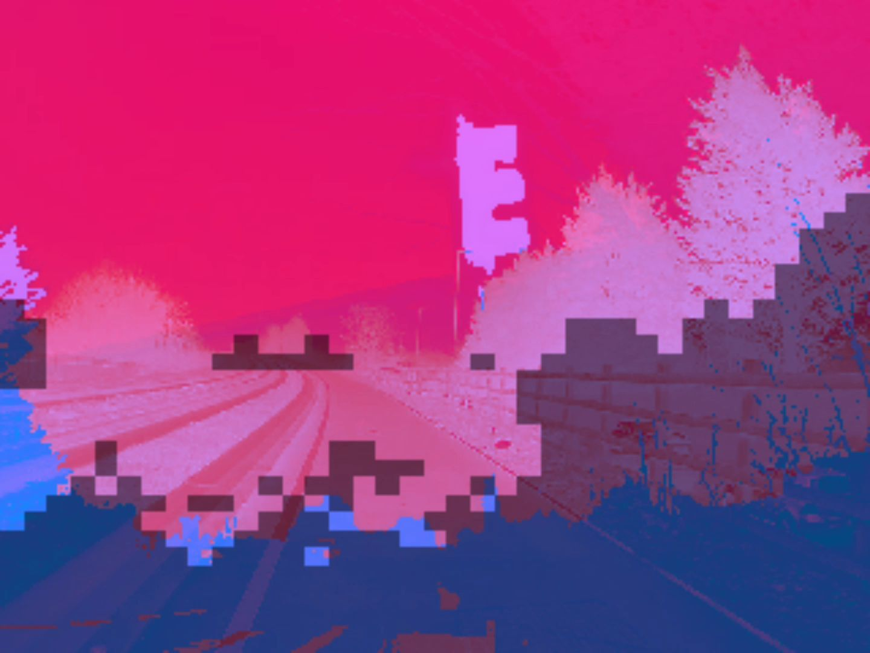Jakub Rokita video still pink and blue fragmented image