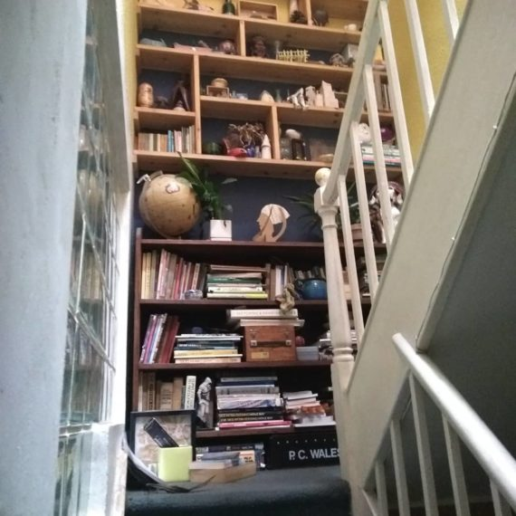 very messy stairs and shelves