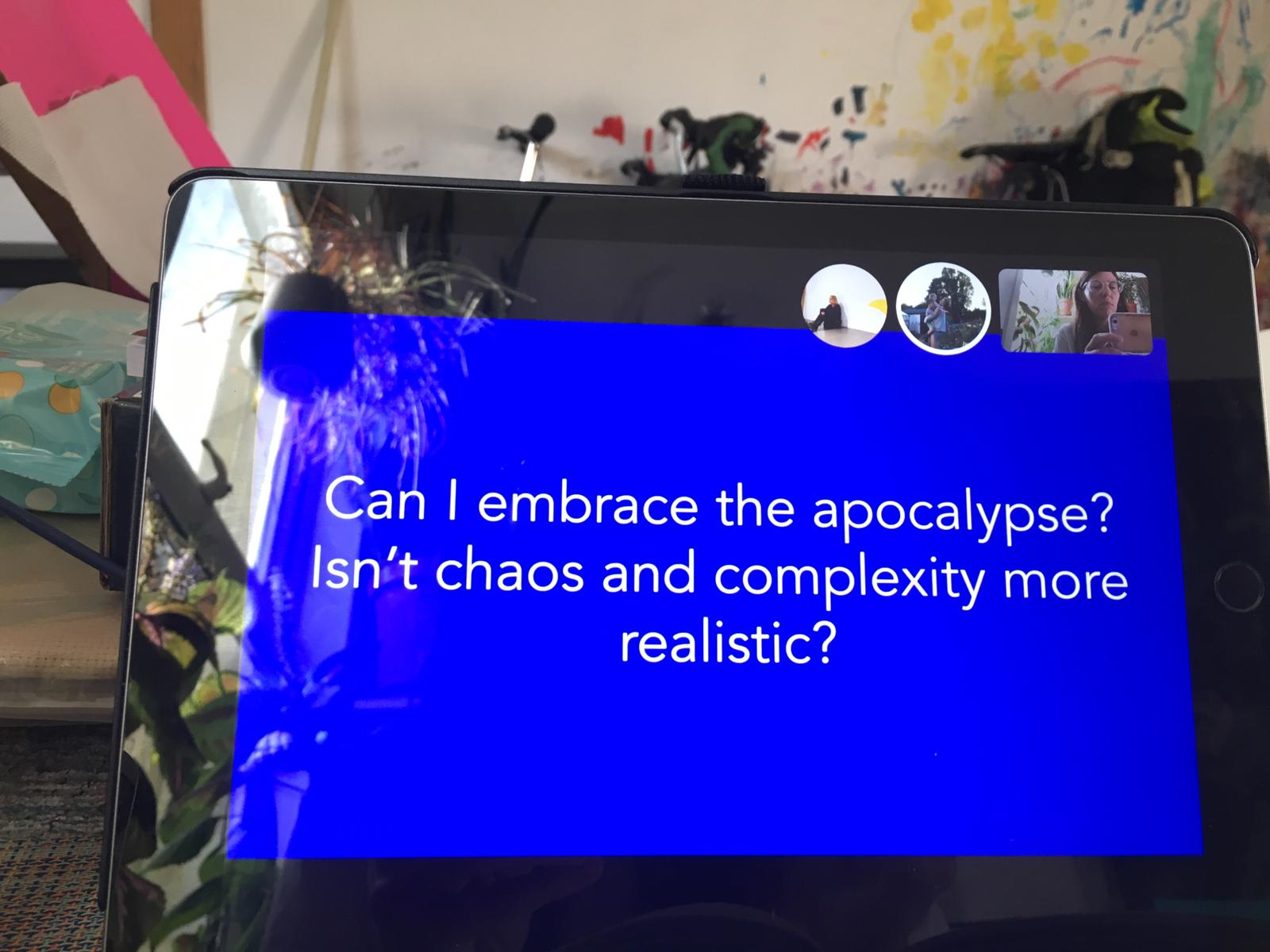 """Photo of a lap top during the Skype call, the screen is blue and written in white text is the questions: """"Can I embrace the apocalypse? Isn't chaoos and complexity more realistic?"""
