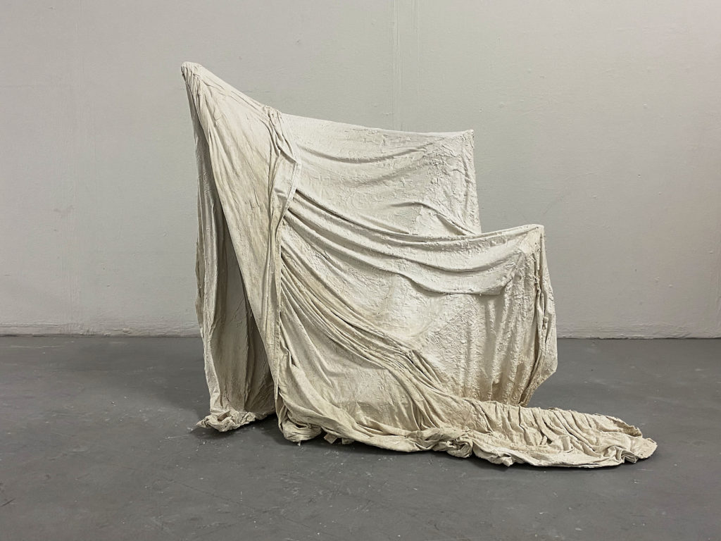Sculpture made from draped, white fabric