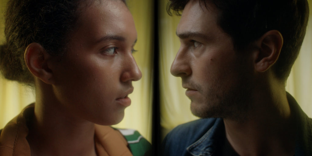 Close-cropped head shots of 2 people staring intensely at each other.
