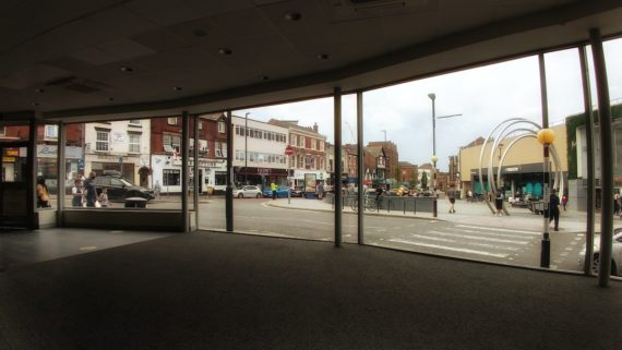 a view of the spot in derby through a wide not tall window
