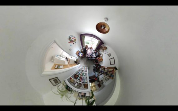 a 360 photograph of andrew working at the dining table