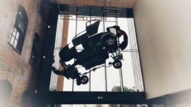 exploded view of toyota car above entrance in museum of making