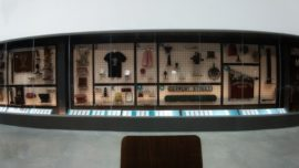 view of museum objects arranged by mateiral in an a to x display
