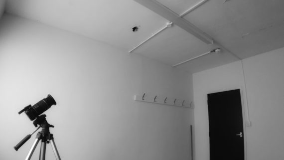 camera on tripod in small commercial space