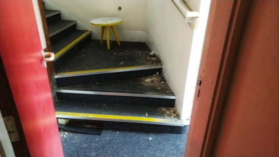 stairs in commercial space with rubble