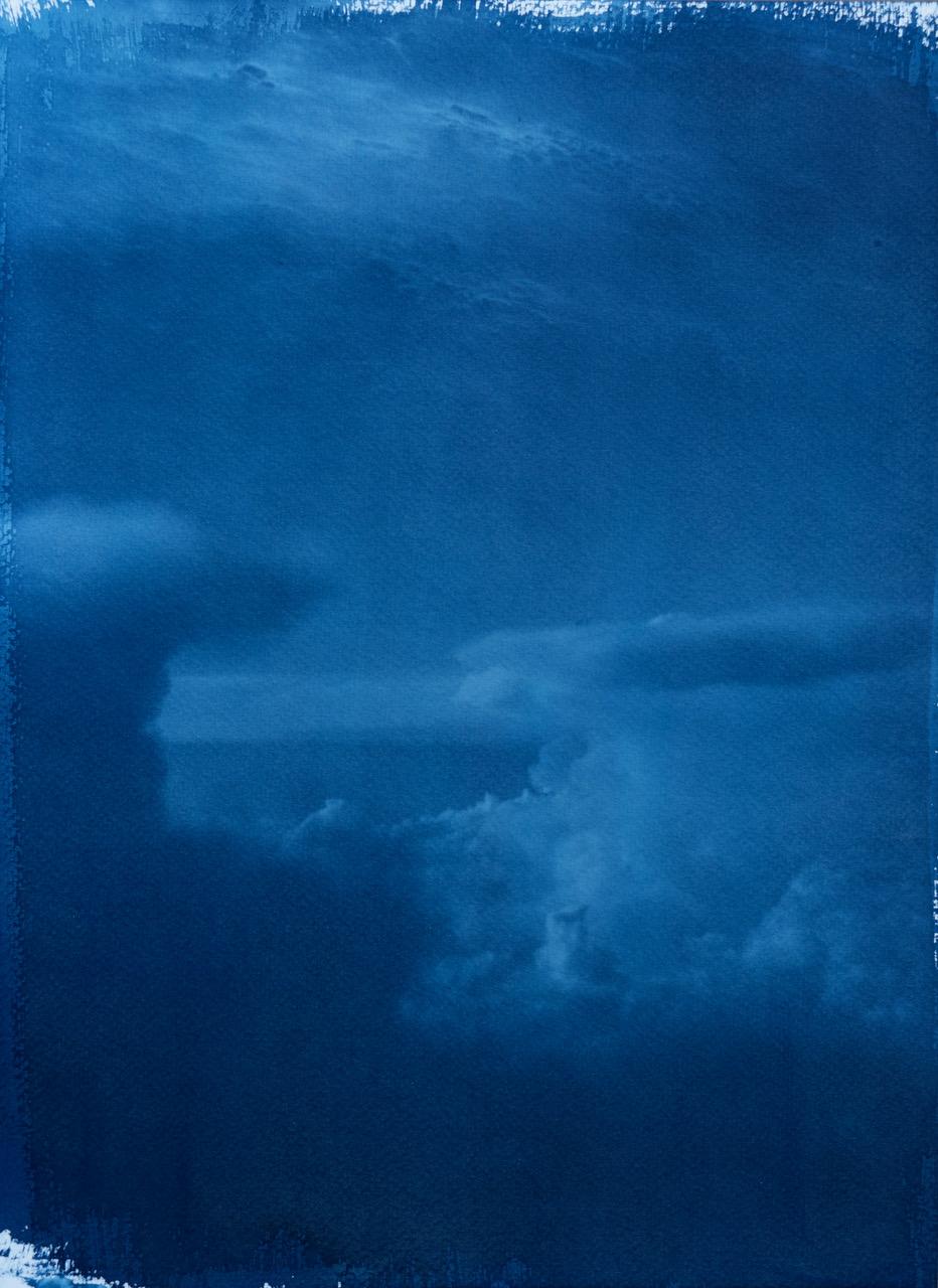 Rich blue painting of a cloudscape